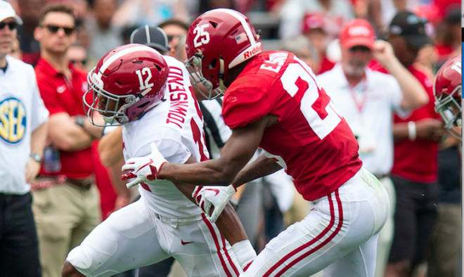 Defensive back Eddie Smith (25) stops wide receiver Chadarius Townsend (12) during second half action in the Alabama A-Day spring football scrimmage game at Bryant Denny Stadium in Tuscaloosa, Ala. Photo | Imagn