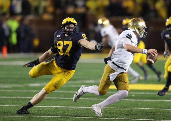 Michigan Wolverines football junior edge defender Aidan Hutchinson was able to participate in some drills during spring ball, after injuring his ankle last season.