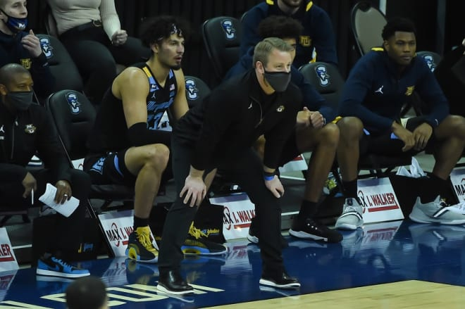 Former Duke player and assistant coach Steve Wojciechowski is playing UNC to benefit his team.