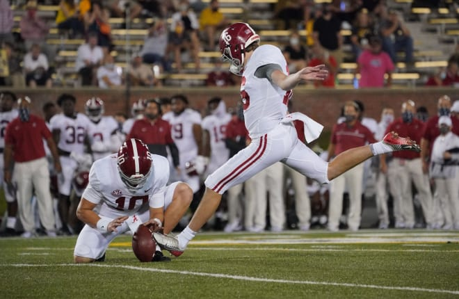 Alabama Crimson Tide place kicker Will Reichard (16) kicks a point after touchdown against the Missouri Tigers during the first half at Faurot Field at Memorial Stadium. Photo | Imagn