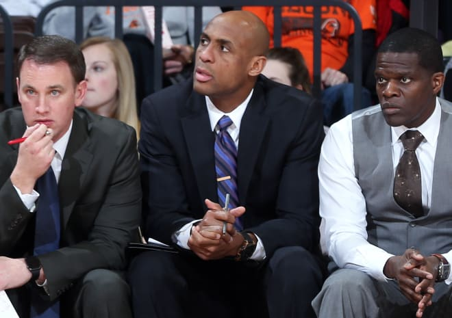 Louis Rowe (middle) sits on the bench during a Bowling Green game this past season.