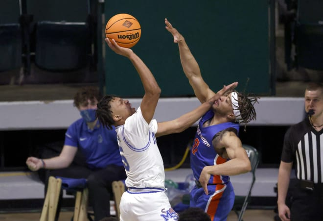 Memphis guard Boogie Ellis (5) shoots as Boise State guard Marcus Shaver Jr. (0) defends during the first half of an NCAA college basketball game in the semifinals of the NIT, Thursday, March 25, 2021, in Denton, Texas.
