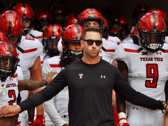 Texas Tech coach Kliff Kingsbury leads the Red Raiders out onto the field against Houston on Saturday.