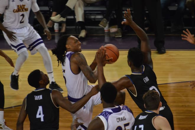 ECU's Kentrell Barkley drives on Tulsa's Junior Etou for two of his 19 points in a 69-66 victory.