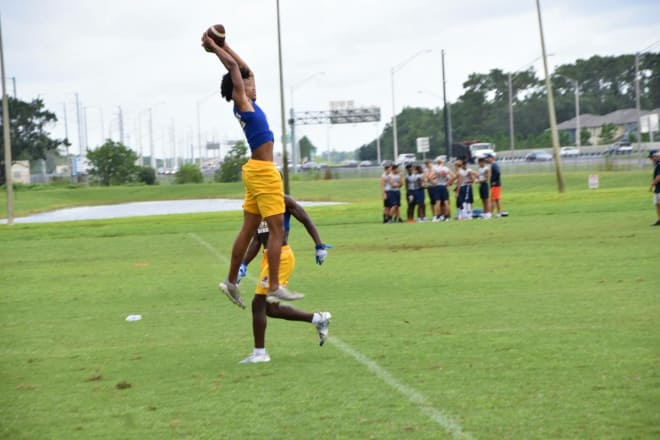Weaver goes up for a pass during summer workouts at his school